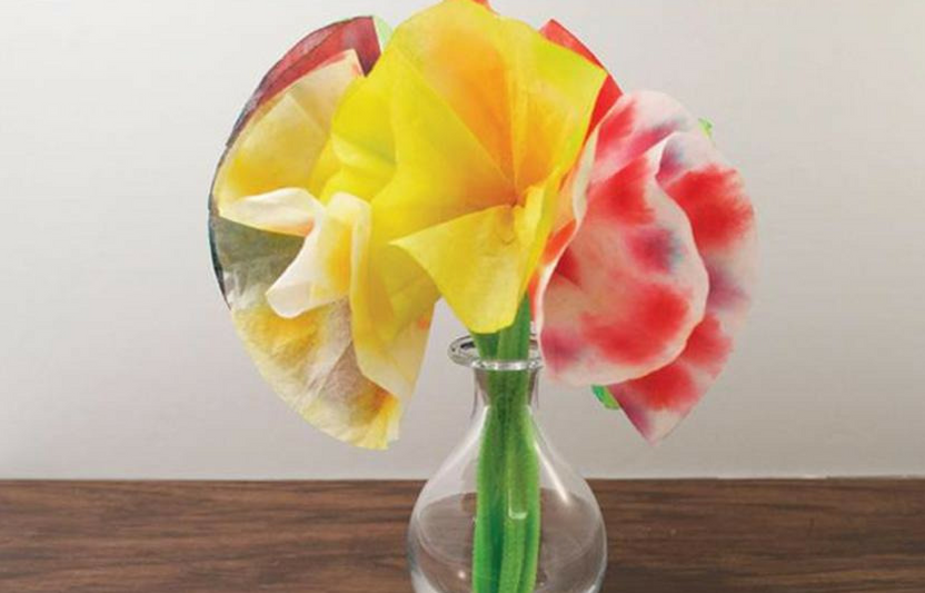 Coffee filters bloom into this beautifully vibrant flower bouquet.