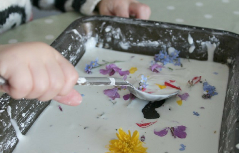 """Add flowers to this thick """"goop"""" mixture then watch your little ones explore stirring and mixing up their flower concoction."""