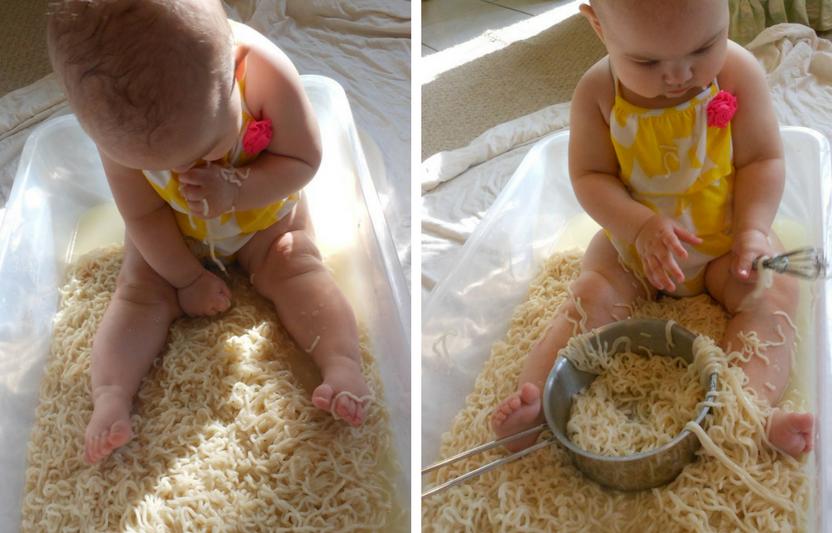 Place baby in a plastic tub of noodles, she's love using all her senses to explore.