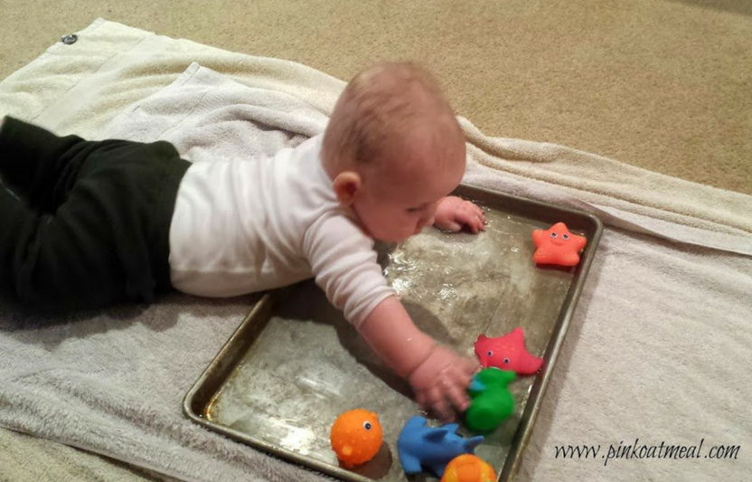 Fill a cookie sheet with a bit of water, then let baby splash around! Add bath time toys for extra fun, but make sure to maintain adult supervision at all times.