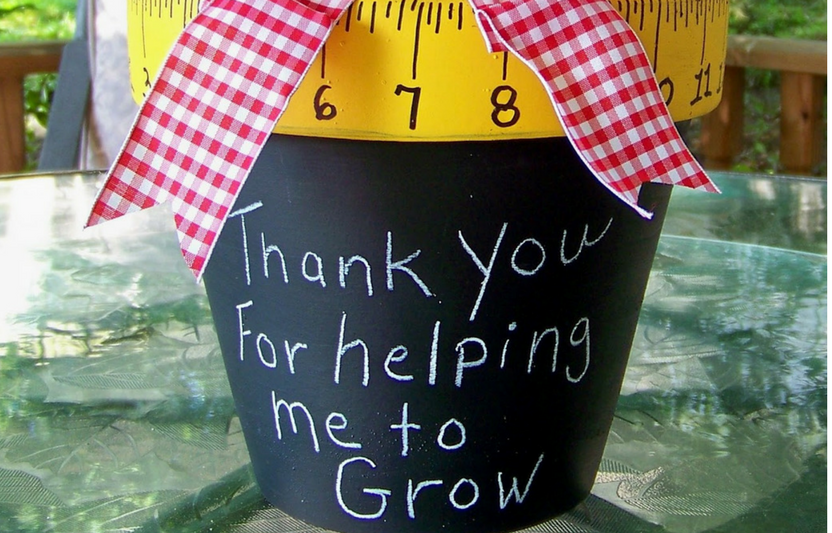 Paint a flowerpot to resemble a ruler and chalkboard.