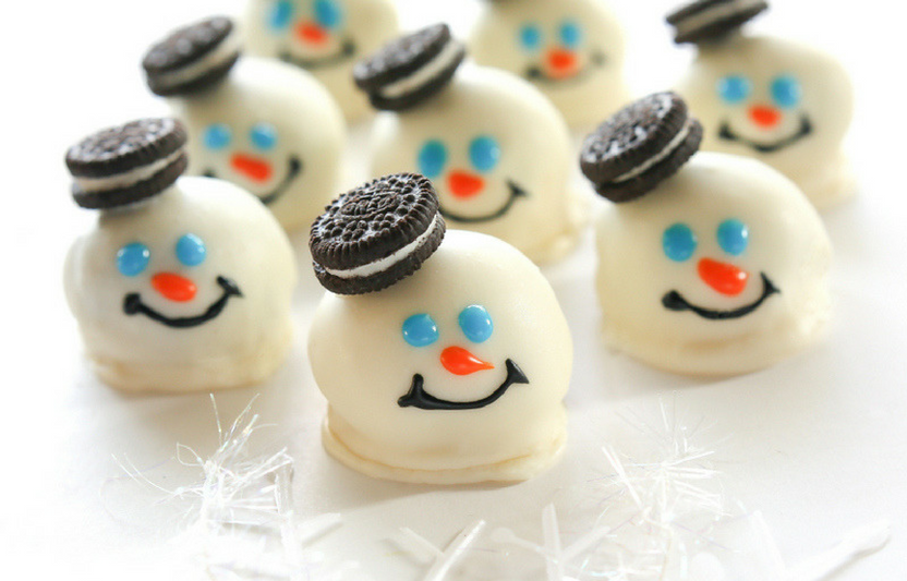Bring the snowman decorating inside; just add frosting eyes, a nose, a mouth, and a chocolate hat!