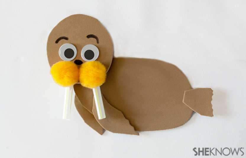 This funny walrus is crafted out of pom poms and straws.
