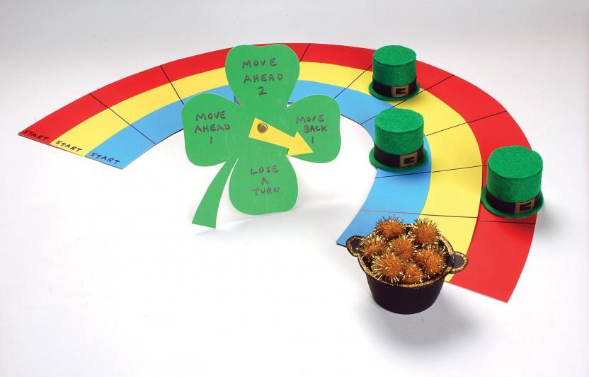 Craft this cute shamrock and rainbow board game with your kids, then play to race to the gold!