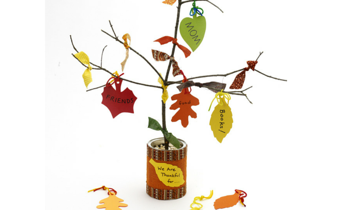 """This homemade """"Thanksgiving tree"""" engages kids to think about the holiday's meaning, plus it makes a beautiful centerpiece on your dinner table."""