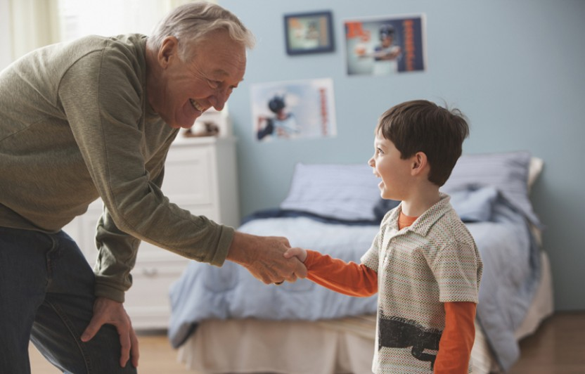 boy shaking hands with grandpa