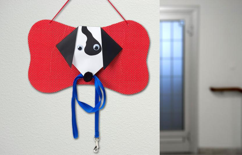 Your kids will be eager to take the family dog on a walk when they can use this adorable leash holder they make themselves.