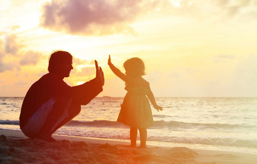 dad and little girl high-fiving