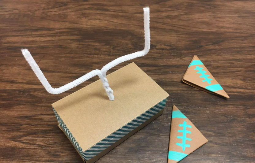 It's fall and time for football! Get in the spirit of the game with your kids as they make this mini-football goalpost and ball. With a few easy-to-find items, they'll be scoring field goals in no time.