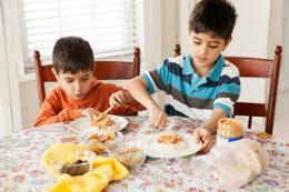 boys spreading peanut butter