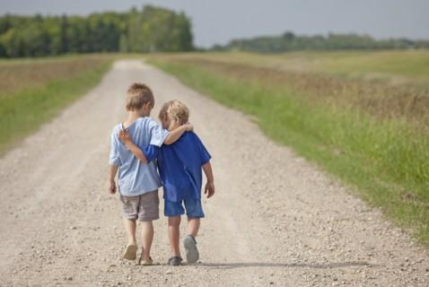boys walking arm in arm