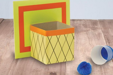 Help your kids get in the spirit of the game by making this mini basketball hoop and ball launcher. Transform cardboard into a backboard and hoop.
